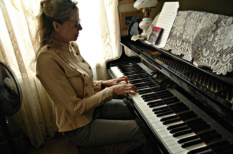 Photo Credit: ESTACADA NEWS PHOTO: ISABEL GAUTSCHI - Award-winning classical pianist Jessica Burnett Dinsdale recently moved to Estacada. She offers piano lessons to all ages.