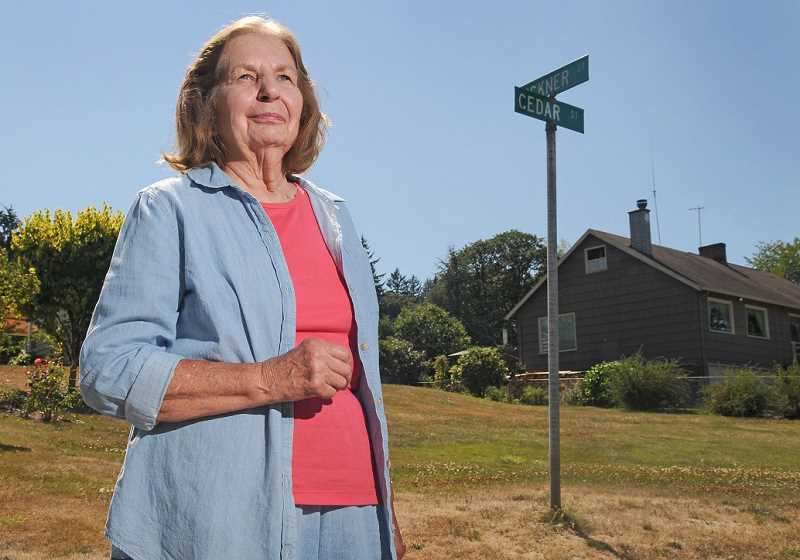 Photo Credit: REVIEW PHOTO: VERN UYETAKE - Neighborhood resident Joanne Rollins stops at the corner of Cedar and Bickner streets in Hallinan Heights. Rollins family once owned the property where four new homes will be built.
