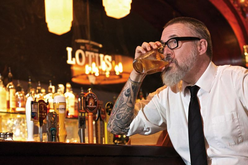 Photo Credit: TRIBUNE PHOTO: JAIME VALDEZ - An occasional beer can be part of the job for Doug Kenck-Crispin, whose Seedy Portland tours take in a number of the citys historic watering holes.