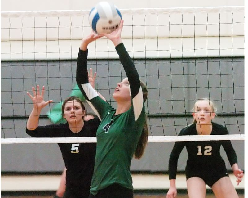 Photo Credit: DAN BROOD - SUPER SETTER -- Sophomore Hannah Miller returns at setter for the Tigard High School volleyball team this season.