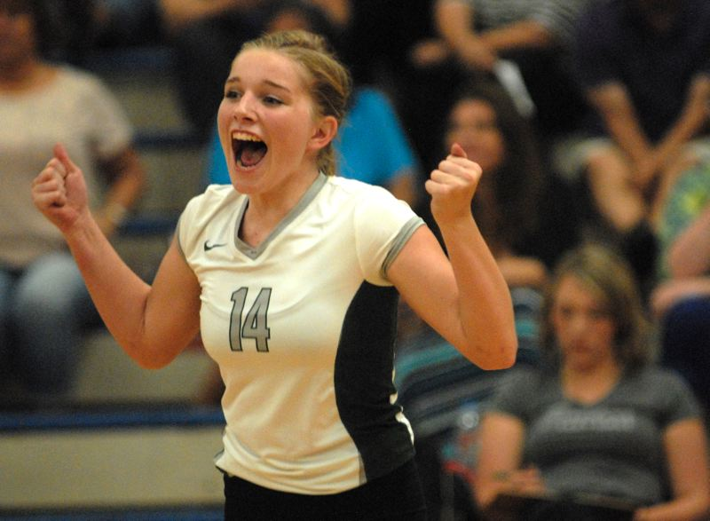 Photo Credit: THE OUTLOOK: DAVID BALL - Reynolds Katelyn Payne celebrates a point during the Raiders three-set win at Centennial in Tuesdays league opener.