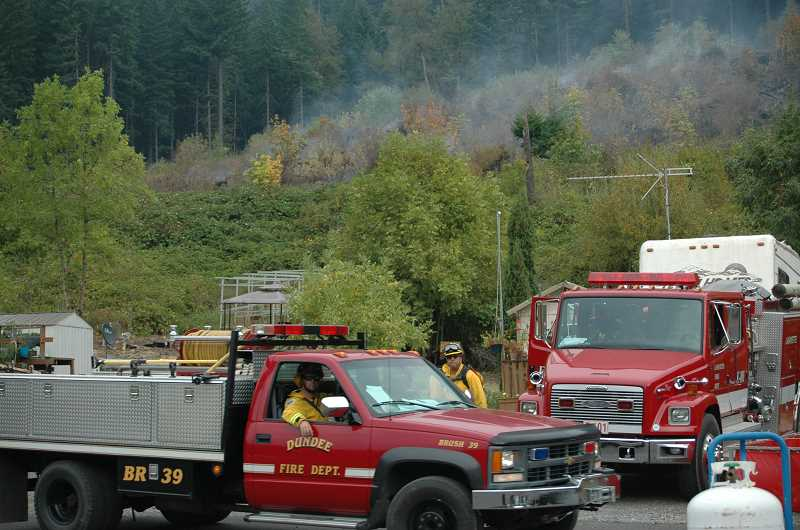 Photo Credit: ESTACADA NEWS PHOTO: ISABEL GAUTSCHI - Fire personnel continue to monitor Silver Fox RV Park and are tasked with protecting the structures there.