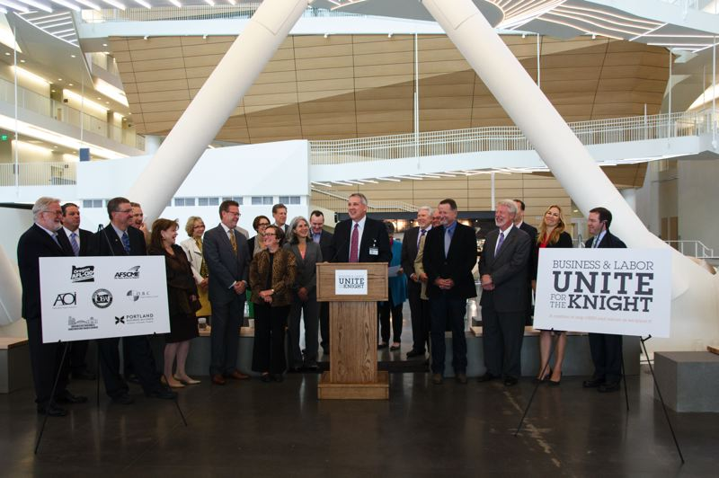 Photo Credit: COURTESY GARD COMMUNICATIONS - OHSU President Dr. Joe Robertson introduces the Unite for the Knight coalition, with business and labor representatives standing together in support of the Knight Cancer Challenge, during a Sept. 23 press conference.