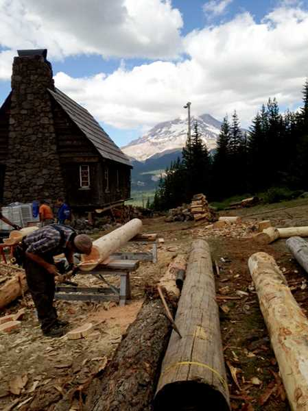Photo Credit: CONTRIBUTED PHOTO - A team of log preservation workers, stonemasons and personnel from both the Mt. Hood National Forest and Skibowl Resort are working to preserve the hut.