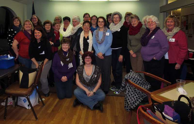 Photo Credit: SUBMITTED PHOTO - Members of the Tigard Knitting Guild show off scarves they made during a knitting workshop. The Guild celebrated its 20th anniversary last week, with plans to grow its membership this year.