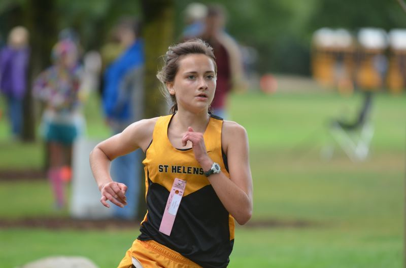 Photo Credit: COREY BUCHANAN, THE SPOKESMAN - St. Helens junior Angela Willson paced the Lady Lions, finishing inside the top-15 for St. Helens during the Sept. 25 meet in Wilsonville.