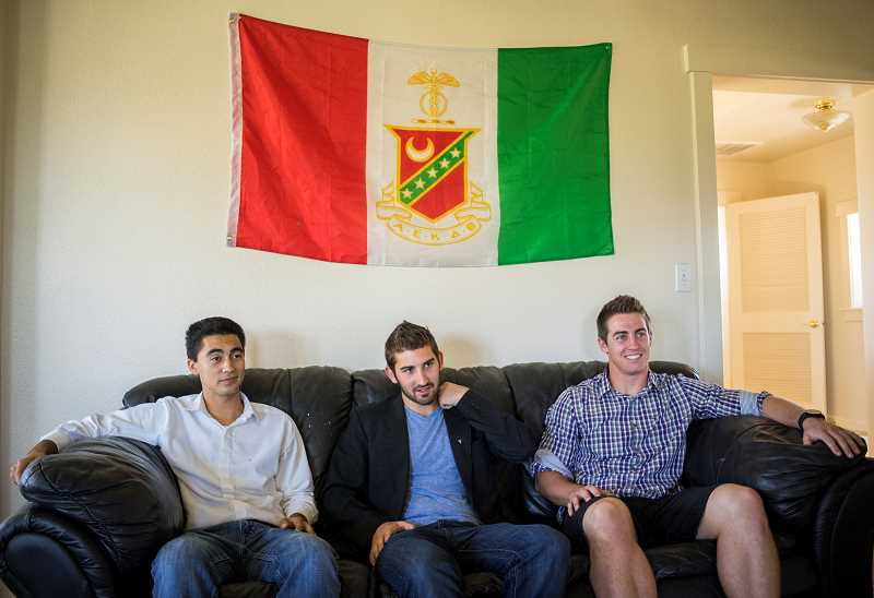 Photo Credit: NEWS-TIMES PHOTO: CHASE ALLGOOD - Sophomores Pablo Nieves-Valenzuela and juniors James Ramos and Ryan Beck are the force behind efforts to establish a Kappa Sigma chapter at Pacific University in Forest Grove. The national fraternitys flag is pinned to the wall inside the trios house on Highway 47.
