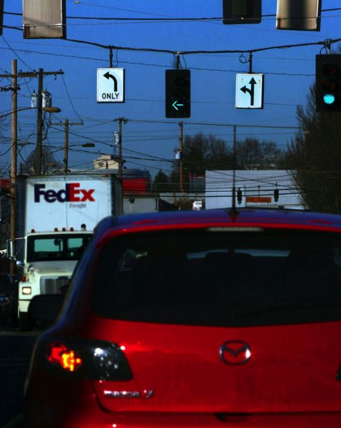 Photo Credit: TRIBUNE FILE PHOTO - It's not just streetlights that are being upgraded to LEDs. City transportation officials upgrading traffic signals across the city with LEDs and sensors buried in the street to move traffic more efficiently.