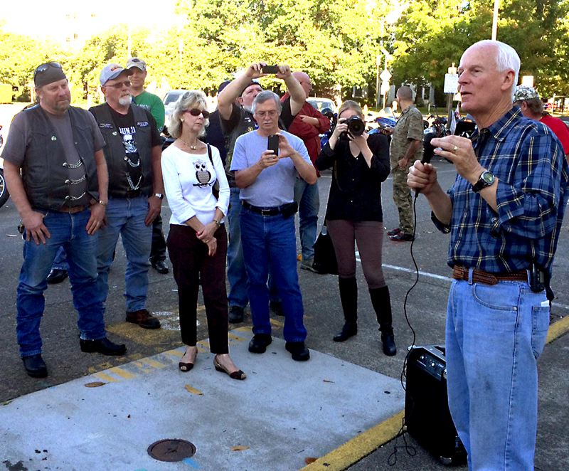 Photo Credit: TRIBUNE PHOTO: PETER WONG - Republican gubernatorial candidate state Rep. Dennis Richardson spoke Monday to a small but enthusiastic crowd of motorcycle riders outside the Capitol in Salem, hitting his opponent, Gov. John Kitzhaber, on a number of issues.