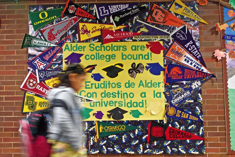 Photo Credit: TRIBUNE PHOTO: JAIME VALDEZ - College banners in the Hall of Dreams at Alder School remind students of Portlands lowest-income school of their special status as the only school in the country adopted by I Have A Dream.