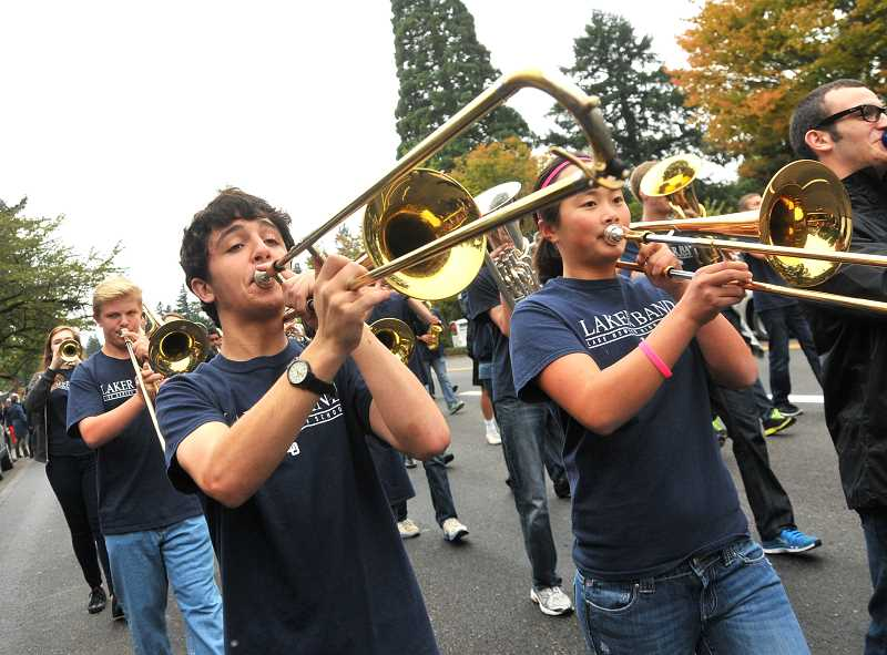 Photo Credit: REVIEW PHOTO: VERN UYETAKE - The band got the homecoming parade rolling, bringing out the brass, from left: Adeline Norris, trumpet; Andrew Ness, trombone; Blake Peebles, trombone; Casey Lum, trombone; and Ethan Agritelley, trombone.