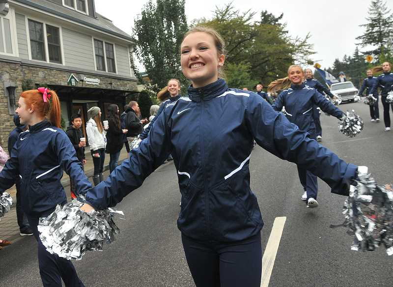 Photo Credit: REVIEW PHOTO: VERN UYETAKE - Callie Shaw, senior captain of the Laker Dancers, shows school spirit.