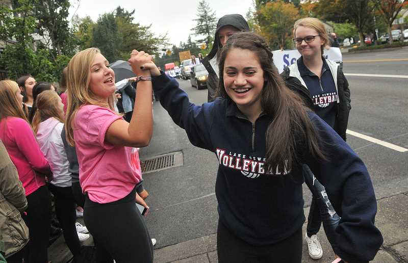 Photo Credit: REVIEW PHOTO: VERN UYETAKE - A volleyball player gets a shout out during the homecoming parade.