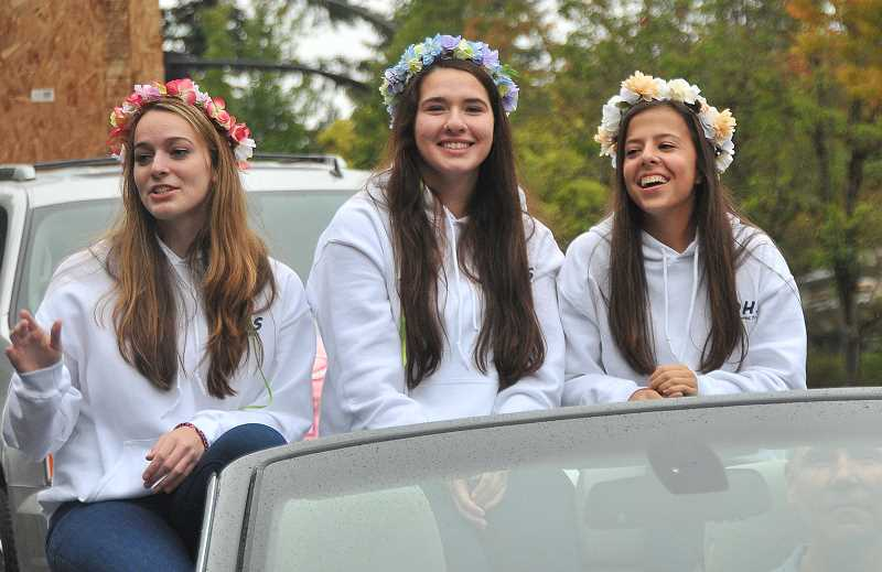 Photo Credit: REVIEW PHOTO: VERN UYETAKE - Three LOHS senior princesses enjoy their parade ride, from left: C.C. Brown, Ann Hill and Jenny Chandler.