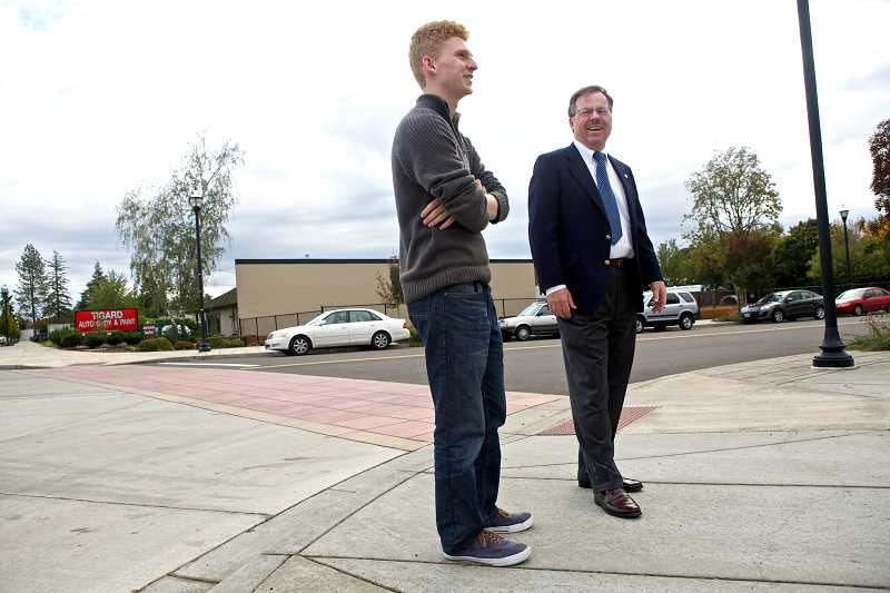 Photo Credit: TIMES PHOTO: JAIME VALDEZ - Tigard High School student Carter Kruse, 17, and real estate agent Neal Brown tour downtown Tigard, where they hope to build a YMCA.