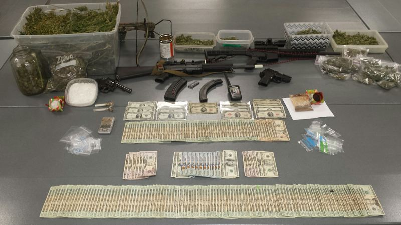 Photo Credit: CLATSOP COUNTY SHERIFF PHOTO - Marijuana, heroin, methamphetamine, guns and cash seized from a home in Clatskanie where four people were arrested. The arrests came after an investigation into a suspect for dealing methamphetamine and heroin.