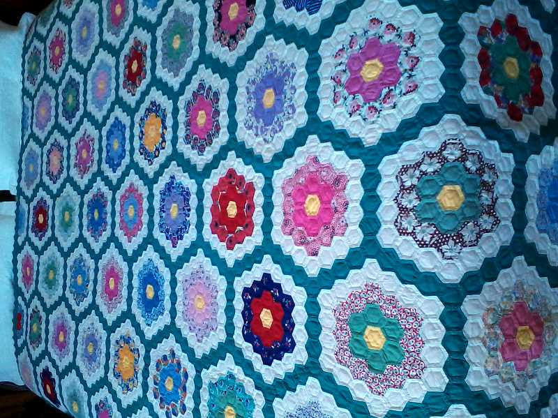 Photo Credit: COURTESY PHOTO - The North Plains library features a different quilt each month from local quilters.