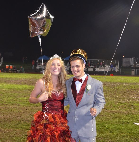 Photo Credit: JOHN BREWINGTON - Sydney Nett and Casey Cooke, king and queen of the 2014 Homecoming Court at St. Helens High School, react after being crowned at the homecoming football game Friday, Oct. 24.