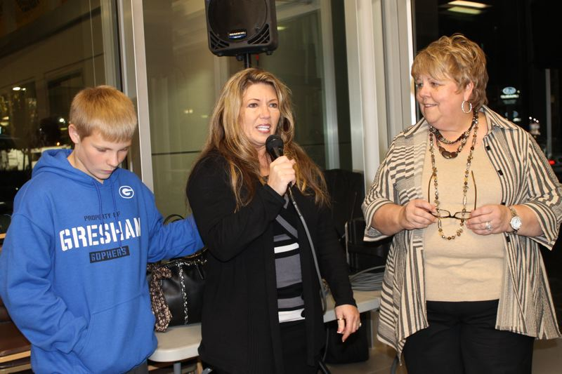 Photo Credit: OUTLOOK PHOTO: ANNE ENDICOTT - Emiriana Shubert (center), with son Trenten and Gresham Ford General Manager Bess Wills, struggled with her emotions as she explained the real reason why she brought Torres and Black to the dealership last Thursday night.