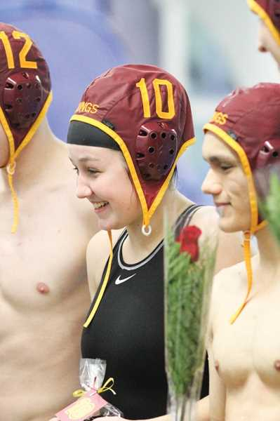 Photo Credit: NEWS-TIMES PHOTO: AMANDA MILES - Katie Hertel is honored along with Forest Grove's other seniors during a pregame ceremony Nov. 3.
