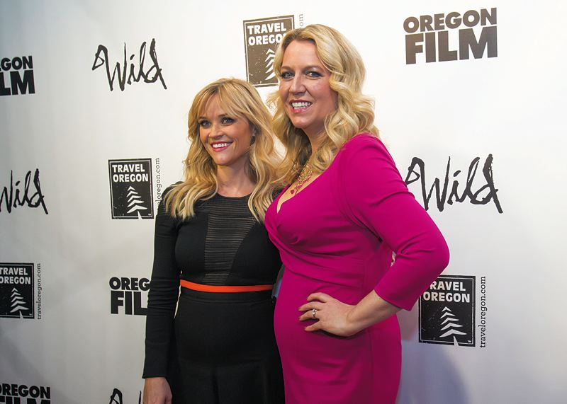 Photo Credit: TRIBUNE PHOTO: JONATHAN HOUSE - 'Wild' author Cheryl Strayed (right) glammed it up with star Reese Witherspoon on the red carpet during the film's Portland premiere at Cinema 21 on Monday.