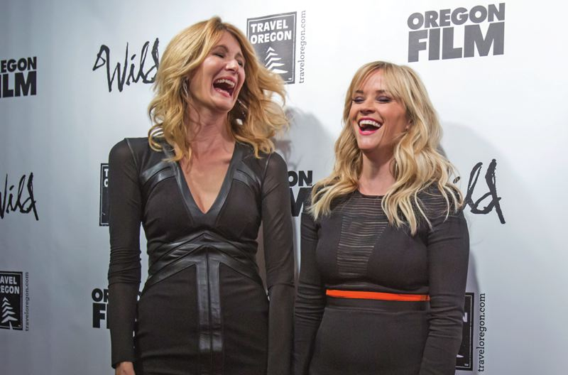 Photo Credit: TRIBUNE PHOTO: JONATHAN HOUSE - Actresses Laura Dern and Reese Witherspoon laugh it up on the red carpet during the Portland premiere of 'Wild.'