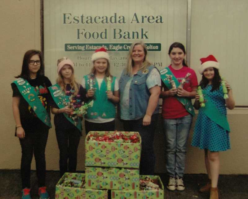 Photo Credit: CONTRIBUTED PHOTO - Eagle Creek Girl Scout Troop No. 45706 has decided to support the Estacada Area Food Bank as part of its leadership project to earn a Bronze Award. The Girl Scouts wrapped and decorated 400 candy packages for the Food Bank to distribute. Pictured from left: Adelia Jeppeson, Kaitlin Willis, Amber Haggstrom, Lily Mixon and Emily Hill.