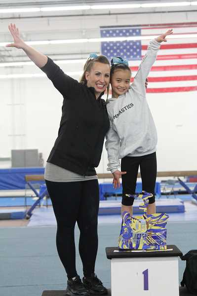 Photo Credit: SUBMITTED PHOTO - Coach Susan Engle and Raynah were exultant after she returned to action and immediately started winning meet titles. Raynahs return to top form amazed Engle.