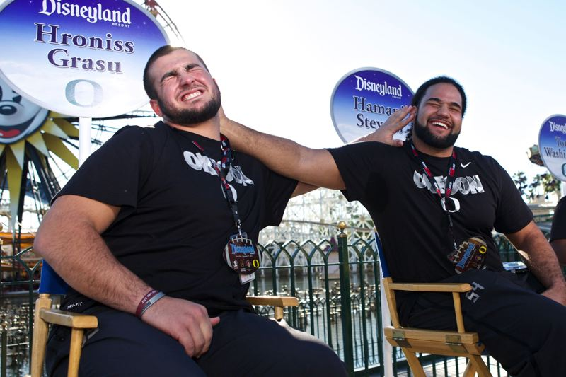 Oregon center Hroniss Grasu (left) and Ducks offensive lineman Hamani Stevens mess with each other during interviews Saturday at Disney California Adventure Park in Anaheim, Calif.