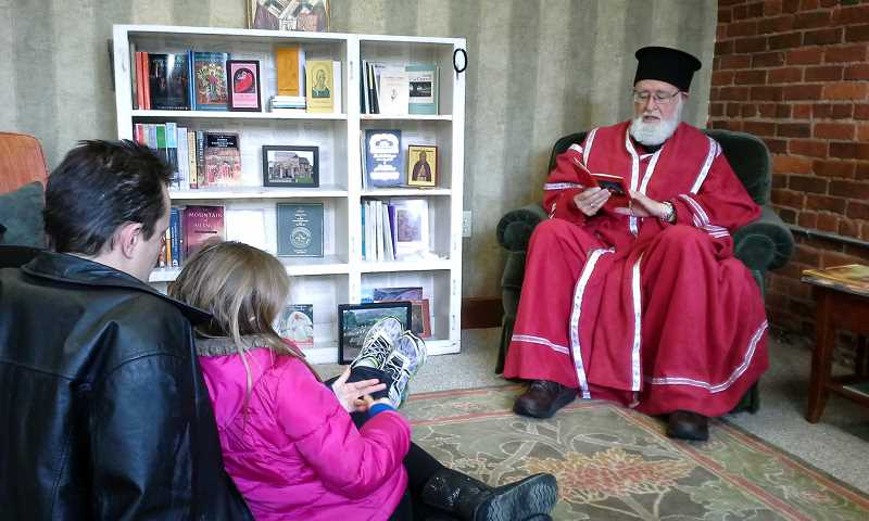 Photo Credit: NEWS-TIMES PHOTO: JILL REHKOPF SMITH - Ted Deming dresses up as Saint Nicholas and reads the original Christmas Story to visitors at The Ancient Church on Pacific Avenue during Holiday in the Grove Dec. 6. The reading room offers information on Orthodoxy through books, music and art.
