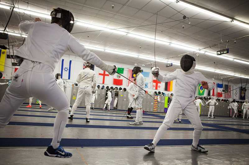 Photo Credit: PHOTOS FOR THE TIMES: ADAM WICKHAM - Fencers hone their skills during the Northwest Fencing Centers International Winter Camp.