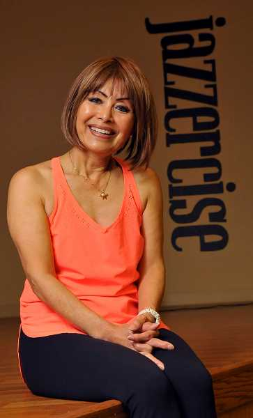 Photo Credit: REVIEW, TIDINGS PHOTO: VERN UYETAKE - Yachiyo McLaughlin was greeted like a returning hero when she arrived to teach her first Jazzercise class at the Wizer Building in 18 months.