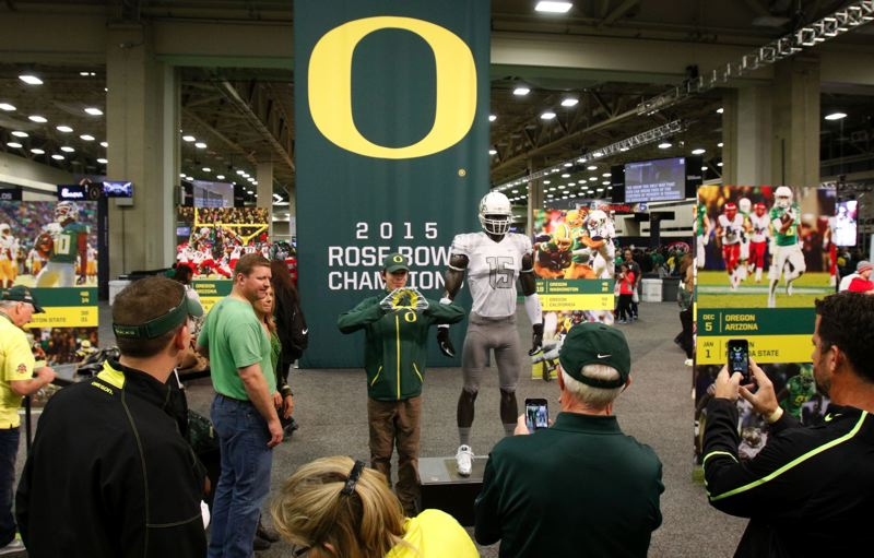 A crowd gathers around the Oregon display.
