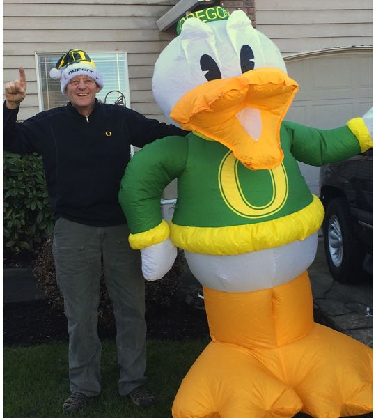 Photo Credit: CONTRIBUTED PHOTO - Unabashed Oregon Ducks fan Rick Parrish, left, is ready for his team to take on the Ohio State University Buckeyes.