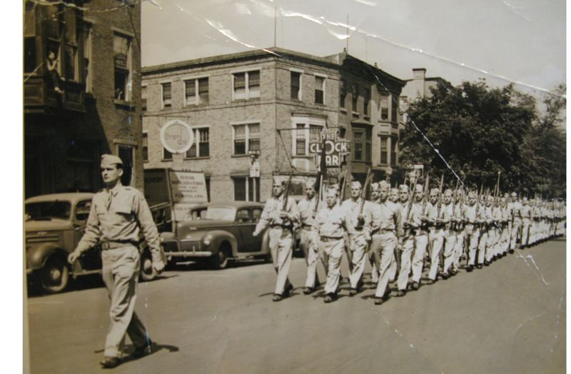 Photo Credit: FAMILY PHOTO - Gregg Wood, leads the Army Medical Corps (left) as a captain serving during World War II.