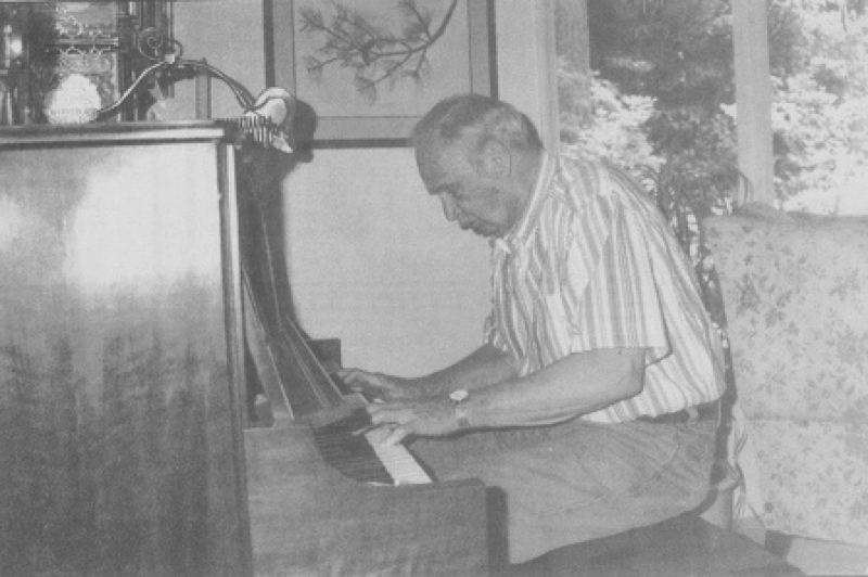 Photo Credit: LAKE OSWEGO REVIEW PHOTO BY: BILL COUTANT - Gregg Wood, here at the Lake Oswego Adult Community Center in 2000, learned a different style of piano playing later in life to accommodate his blindness and not being able to read music.