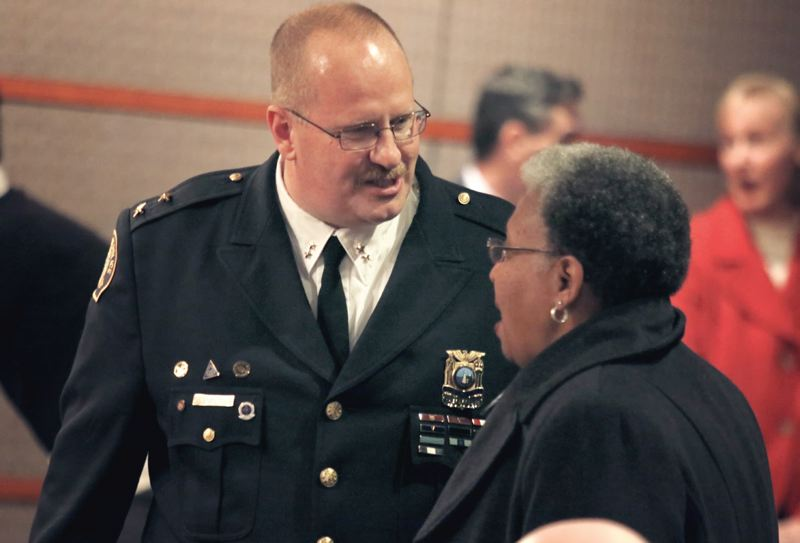 Photo Credit: TRIBUNE PHOTO: JONATHAN HOUSE - Portland Police Chief Larry ODea talked with civil rights leader Avel Gordly after being sworn in Thursday.