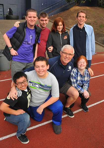 Photo Credit: REVIEW, TIDINGS PHOTO: VERN UYETAKE - When it comes to helping Lake Oswego students participate in track, nobody beats Eric Lider. In the front row, left to right, are Irving Herrera, David Holmes, Eric Lider and Megan Schiedler. In back are C.J. Yapp, Matthew Switzer, Emily Rich and Wyatt Isaacs.