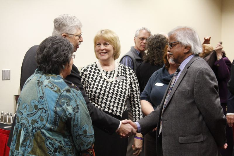 Photo Credit: CONTRIBUTED PHOTO: BRUCE BATTLE - Arun Gandhi, grandson of Mahatma Gandhi, right, visits with Debra Derr, president of Mt. Hood Community College, center, on Thursday, Jan. 22, at the Gresham campus.