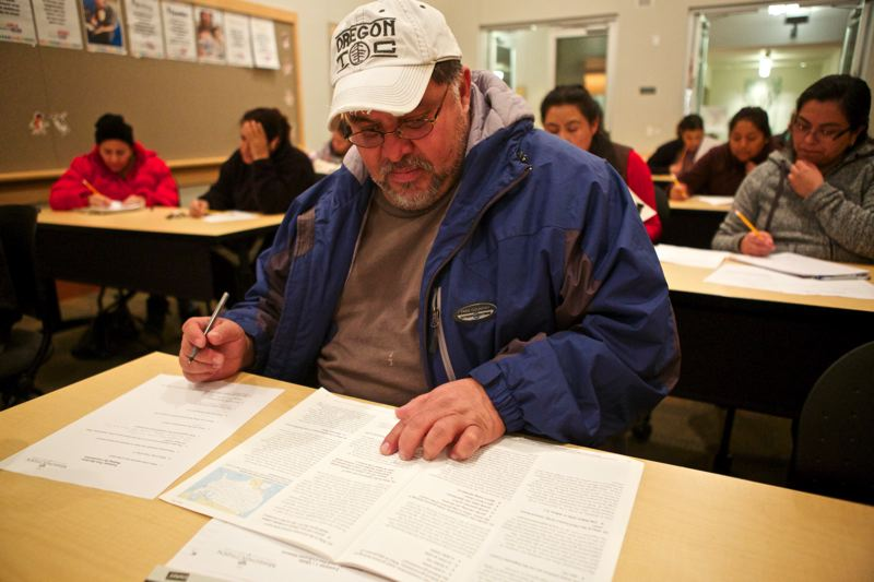 Photo Credit: TIMES PHOTO: JAIME VALDEZ - Pablo Tellez of Tigard takes a practice quiz during a Mission Citizen class at the Tualatin Library.