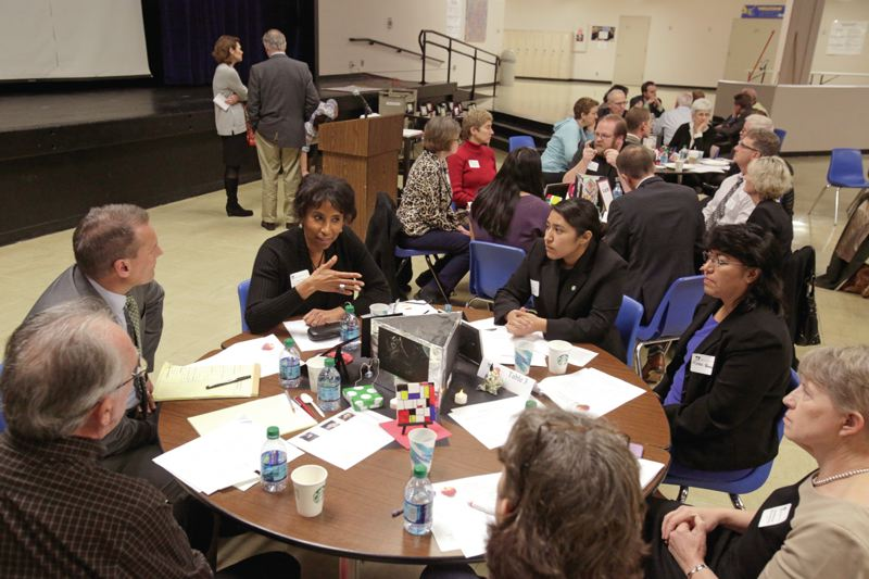 Photo Credit: TIMES PHOTO: JONATHAN HOUSE - Beaverton School Board member Donna Tyner, upper left, talks during a roundtable discussion at the Washington County Schools Legislative Forum.