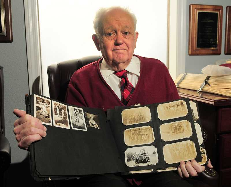 Photo Credit: REVIEW, TIDINGS PHOTO: VERN UYETAKE - A battered old family scrapbook from 1925 is displayed by Richard Halliday. He started his genealogy career by researching his own family.