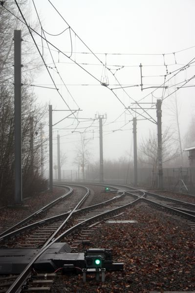 Photo Credit: HILLSBORO TRIBUNE PHOTO: DOUG BURKHARDT - Fog shrouds MAX light rail tracks over the weekend, making a mid-morning scene look like dusk. The fog has been thick across the area for several days, but the weekend weather forecast suggests the sun may soon be back to burn the fog away, with partly sunny skies and temperatures in the mid-50s expected.