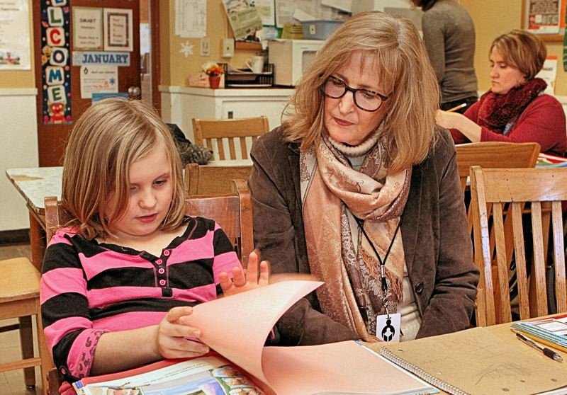 Photo Credit: DAVID F. ASHTON - Student Bella Williams says she loves to read with her SMART volunteer, Sally Rhys.
