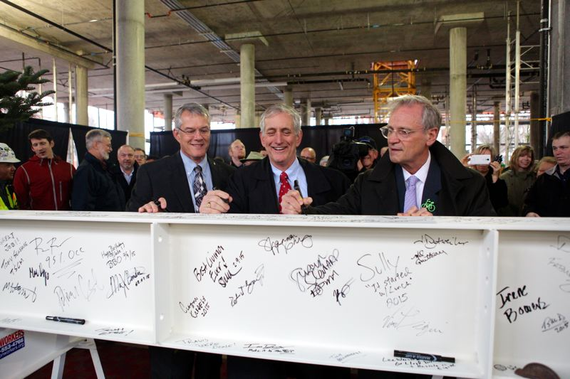 Photo Credit: PORTLAND TRIBUNE PHOTO JAIME VALDEZ - The final beam for the Hassalo on Eighth project is signed by Oregon Congressman Earl Blumenauer (D-Dist. 3), Mayor Charlie Hales, and Wade Lange, Vice President and Regional Manager of American Assets Trust, Inc., the development company.