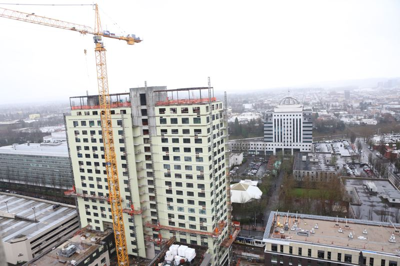 Photo Credit: PORTLAND TRIBUNE PHOTO JAIME VALDEZ - The tallest tower of the Hassalo on Eighth project has reached its maximum height in the Lloyd District.