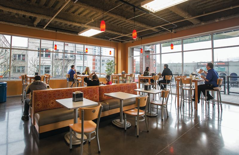 Photo Credit: TRIBUNE PHOTO: JONATHAN HOUSE - The revamped Stadium Fred Meyer in Northwest Portland encourages shoppers and neighbors to linger with cafe seating, stimulating views and a sushi bar.