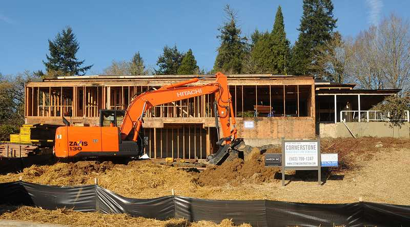 Photo Credit: REVIEW PHOTO: VERN UYETAKE - Construction continues on the Shaw House at the site of the 2015 Street of Dreams, which will be held at the intersection of Goodall and Knauss roads in Lake Oswego.
