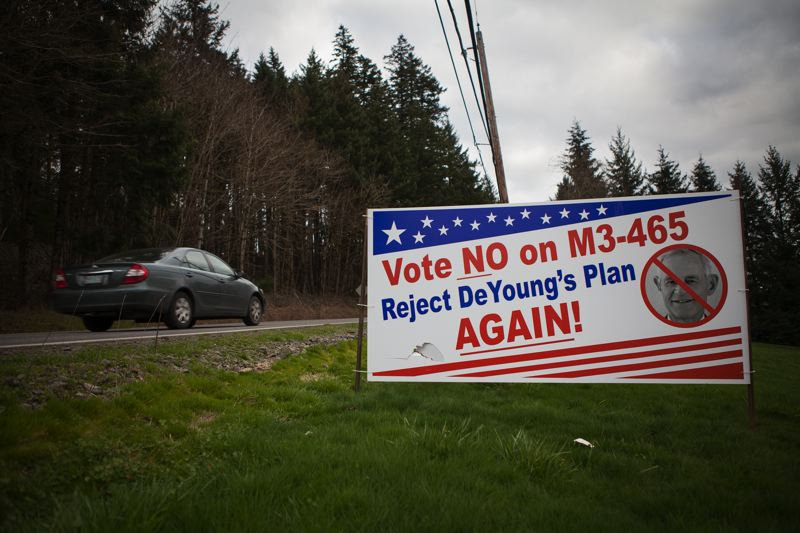 Photo Credit: ADAM WICKHAM - Signs posted around Damascus urge residents to vote no on the comp plan on March. 10