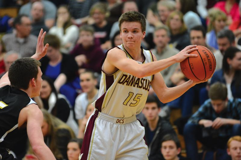 Photo Credit: THE OUTLOOK: DAVID BALL - Damascus Christians Seth Murphy looks for an open passing lane from the 3-point arc.
